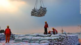 Workers transport bags of soybean meal in a dockyard in Nantong in east China's Jiangsu province Monday, Aug. 06, 2018. China could reduce its soybean imports by 10 million tons this year.PHOTOGRAPH BY Feature China / Barcroft Images (Photo credit should read Feature China / Barcroft Images / Barcroft Media via Getty Images)